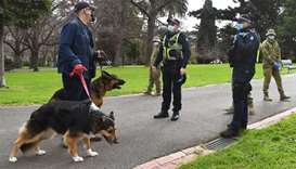 Police officers and soldiers patrol Treasury Gardens as they enforced strict lockdown laws in Melbou