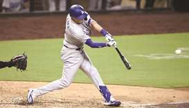 AJ Pollock of the Los Angeles Dodgers hits an RBI double during the seventh inning of their game aga