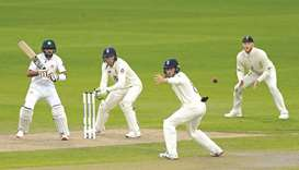 Pakistan's Babar Azam (left) plays a shot as England's Jos Buttler (second from left), Ollie Pope an