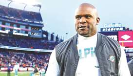 Head coach Brian Flores of the Miami Dolphins exits the field after a win over the New England Patri