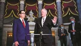 Meadows (right) and Mnuchin speak to the media after a meeting with Pelosi and Schumer on coronaviru