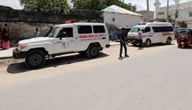 An ambulance is seen near a blast site that rocked a military base in Mogadishu, Somalia