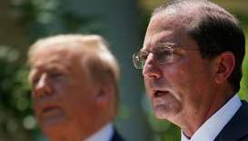 US Secretary of Health and Human Services Alex Azar (R) a senior member of US President Donald Trump