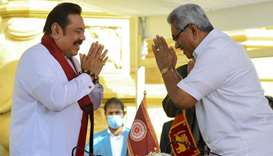 Sri Lakan President Gotabaya Rajapaksa (R) swears in his elder brother Mahinda Rajapaksa (L) as Sri