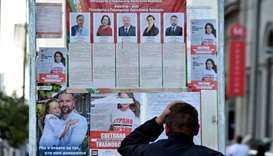 A man reads pre-election posters  in central Minsk