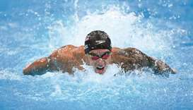 USA's Caeleb Dressel competes in the final of the men's 100m butterfly swimming event during the Tok