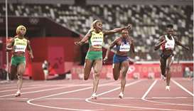 Jamaica's Elaine Thompson-Herah (centre) after winning the women's 100m final during the Tokyo 2020