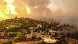 This aerial photograph shows houses surrounded by a wildfire which engulfed a Mediterranean resort r