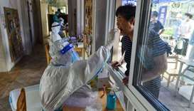 A resident receives a nucleic acid test for the Covid-19 coronavirus in Nanjing in China's eastern J