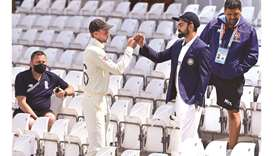 England's captain Joe Root (second from left) greets his Indian counterpart Virat Kohli (second from
