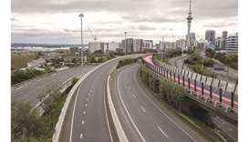The normally busy central motorway interchange is deserted mid-morning in Auckland, New Zealand, ear