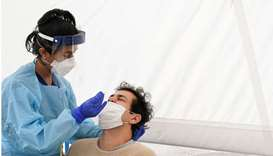 A medical worker administers a test for Covid-19 on a member of the public at a pop-up testing centr