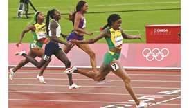 Jamaica's Elaine Thompson-Herah (right) crosses the finish line to win the women's 200m final during