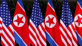 (File photo) US and North Korean national flags are seen at the Capella Hotel on Sentosa island in S
