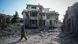 An Afghan security personnel inspects the site a day after a car bomb explosion in Kabul on Wednesda