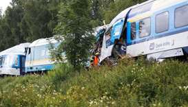 A firefighter works on a site of a train crash near the town of Domazlice, Czech Republic. REUTERS/D