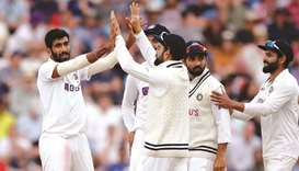 India's Jasprit Bumrah (left) celebrates with teammates after taking the wicket of England's Jos But