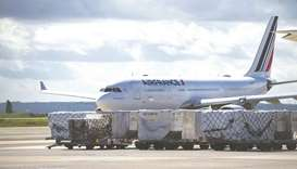 Cargo on trolleys beside an Airbus SE A330 passenger aircraft, operated by Air France-KLM, at Charle