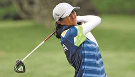 India's Aditi Ashok plays a shot during round one of the women's golf at the Tokyo Olympics in Saita