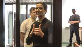 Maria Kolesnikova gestures inside the defendants' cage at the opening of her trial in Minsk yesterda