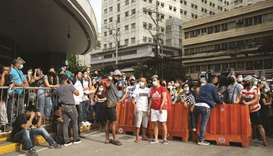 Filipinos waiting to be vaccinated against Covid-19 gather outside a mall in Manila yesterday.