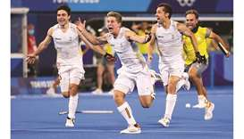 Belgium players celebrate after winning the penalty shoot-out against Australia in the Tokyo Olympic