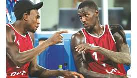 Qatar's Cherif Younousse (right) and Ahmed Tijan talk to each other during a break in their men's be