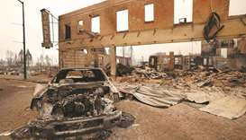 A burned-out car and commercial building are seen in the town of Greenville.