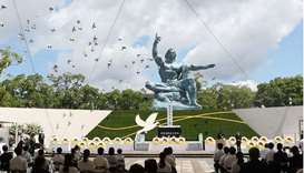 Doves fly during a memorial service for victims of the US atomic bombing at the Nagasaki Peace Park