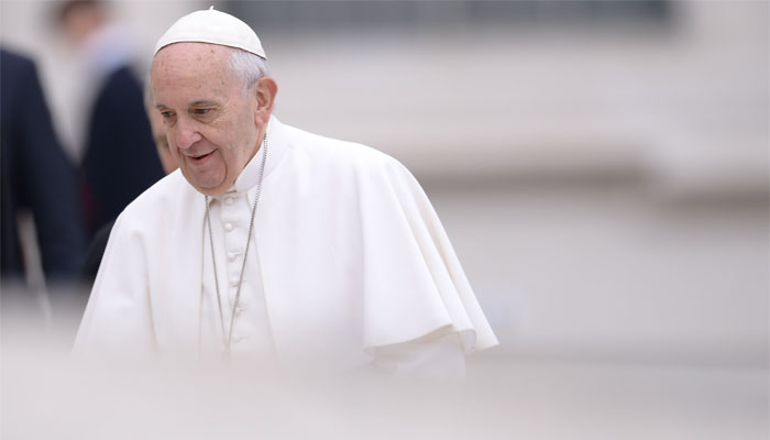 Pope Francis leaves at the end of his weekly general audience at St Peter's square at the Vatican. A