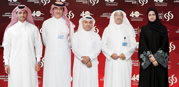 Commercial Bank CEO Abdulla Saleh al-Raisi with members of the executive committee.