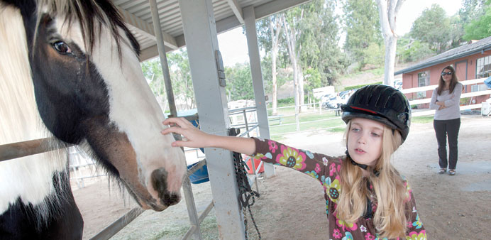 HEALING TOUCH: Darcelle Scott rode with Lady Chandora during a therapeutic riding session with Senec