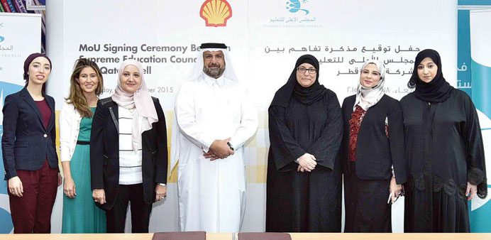 SEC and Qatar Shell officials at the signing ceremony.