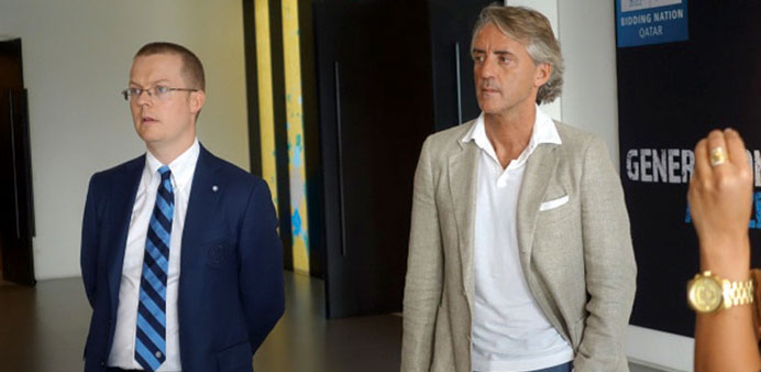 Roberto Mancini (right) during his visit to Doha recently.