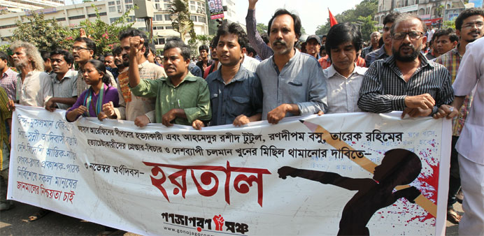Protesters march in Dhaka