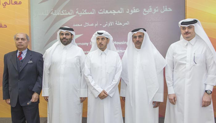 Qatar signs first contracts on 'cities' for 180,000 workers