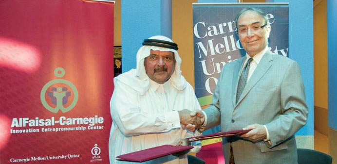 HE Sheikh Faisal and dean Baybars shake hands after signing the agreement.