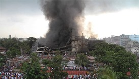 Smoke and flames billow from a burning factory in Tongi