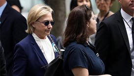 Clinton falls ill at 9/11 memorial, cancels California trip