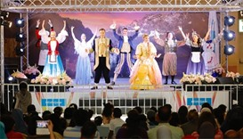 Beauty and the Beast performers sing and dance on stage