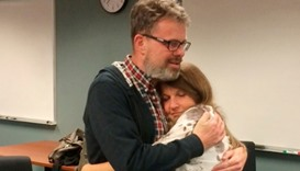 Kevin Garratt, a Canadian held in China for two years on suspicion of spying, hugs his wife Julia Ga