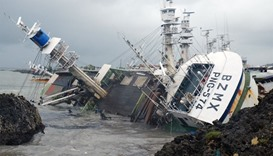 A general view shows an overturned fishing boat in the aftermath of super typhoon Meranti, at Sizihw