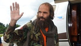 Freed Norwegian national Kjartan Sekkingstad waves as he prepares to board a plane