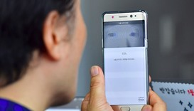 A South Korean man sets up iris recognition function on his replacement Samsung Galaxy Note7 smartph