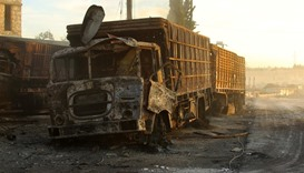 Damaged aid trucks are pictured after an airstrike on the rebel held Urm al-Kubra town, western Alep