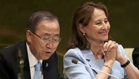 French Minister for Environment Segolene Royal sits with UN Secretary General Ban Ki-moon
