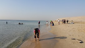 Qatar residents enjoying the waters at Sealine beach