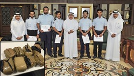 Officials with the employees honoured for their efforts. Inset: Marijuana packets seized from HIA
