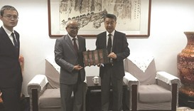QNA director general visits Xinhua office