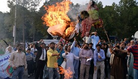 Pakistani Kashmiris burn effigies of Indian PM Narendra Modi and Foreign Minister Sushma Swaraj duri